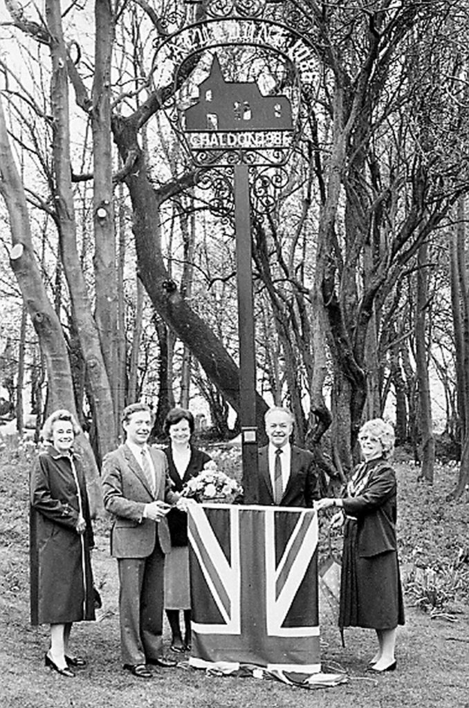 Pam Alexander, John Rawling, Mrs Rawling, Patrick Alexander, and Lindsey Narcissi (Chairman of Tandridge District Council) 5 May 1986, photo from the Bourne Society Village Histories 7 Chaldon.