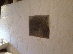 Sundial on interior stone wall at Tollsworth